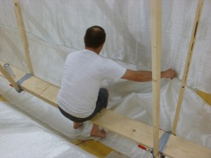 You need all your hands and feet to apply the fiber glass