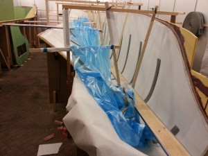 Supports on the bulkheads make it easier to apply the vacuum bag in the hull